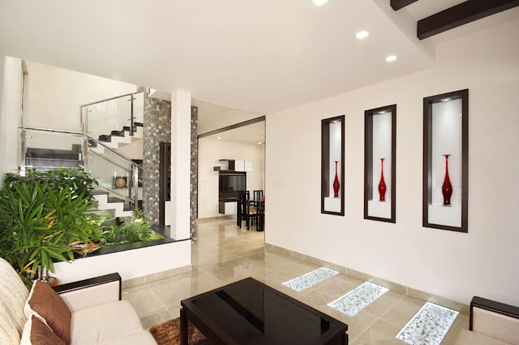 Residence at Kerala :  Living room by Sanskriti Architects