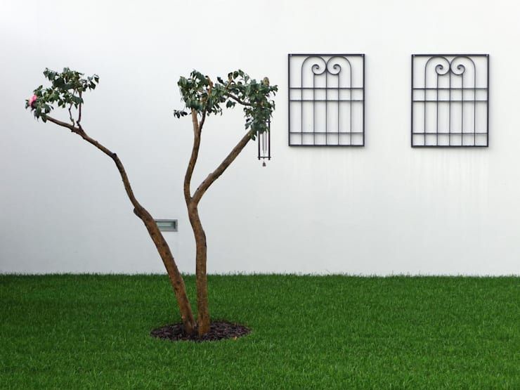 Jardines de estilo  por Sónia Cruz - Arquitectura