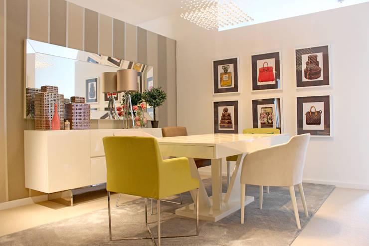 Projekty,  Jadalnia zaprojektowane przez Movelvivo Interiores