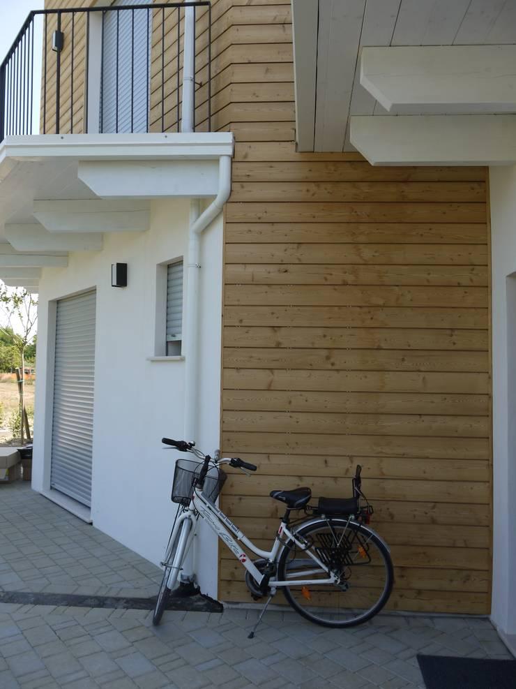 particolare ingresso: Case in stile  di Archética