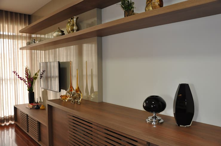 Sala de estar: Salas de estar  por Novità - Reformas e Soluções em Ambientes