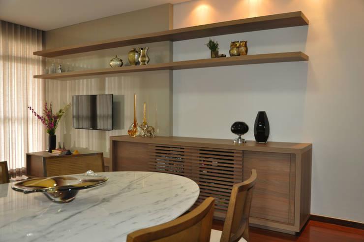 Sala de estar/ jantar: Salas de jantar  por Novità - Reformas e Soluções em Ambientes