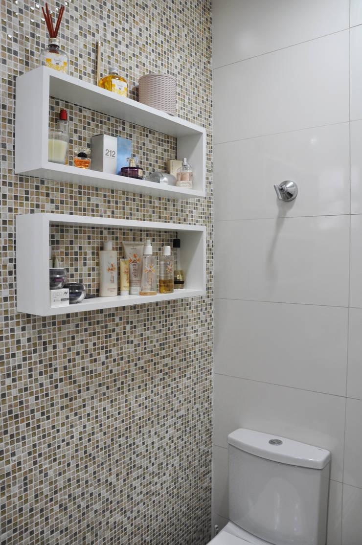 Banho suite master: Banheiros  por Novità - Reformas e Soluções em Ambientes