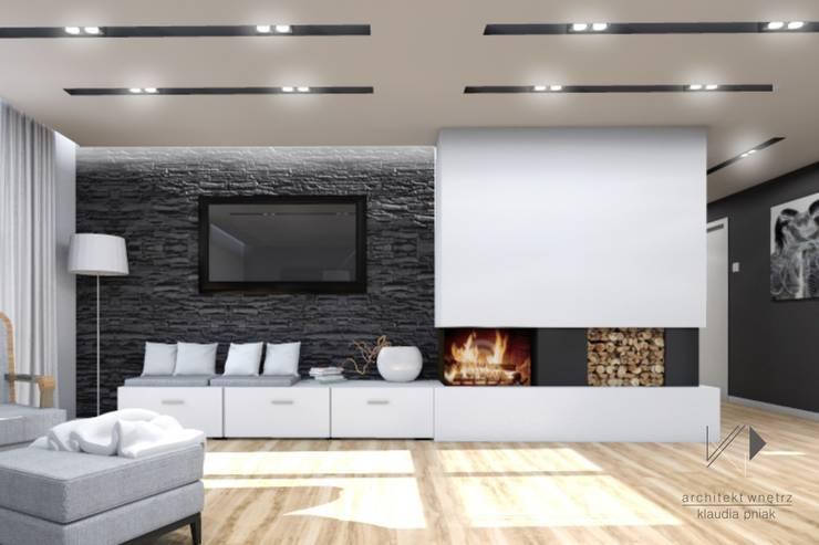 Salon z kominkiem : styl , w kategorii Salon zaprojektowany przez Architekt wnętrz Klaudia Pniak,