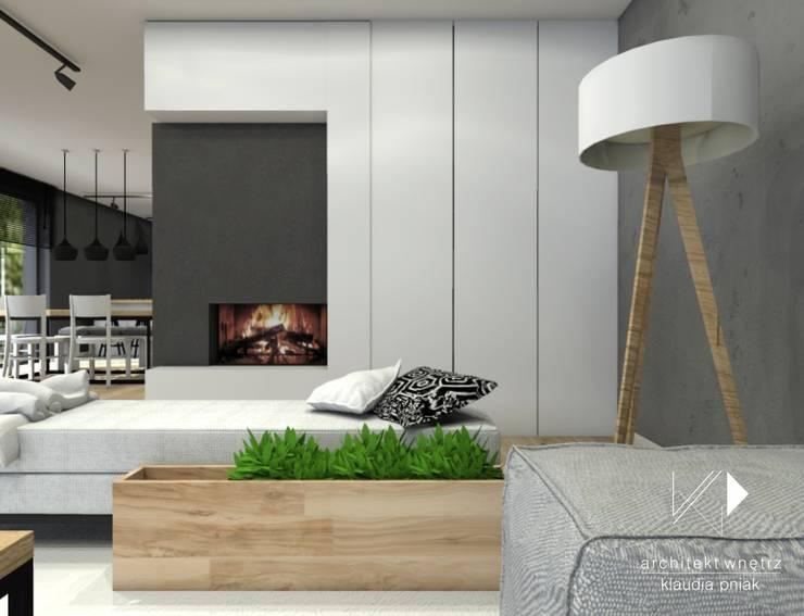 Kominek w salonie i chowane miejsce pracy: styl , w kategorii Salon zaprojektowany przez Architekt wnętrz Klaudia Pniak