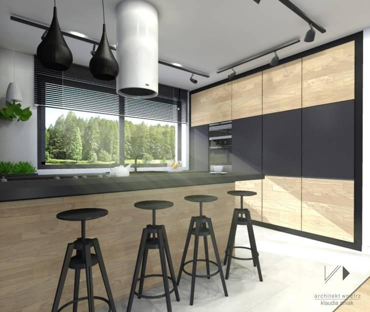 Kuchnia z miejscem barowym : styl , w kategorii Kuchnia zaprojektowany przez Architekt wnętrz Klaudia Pniak