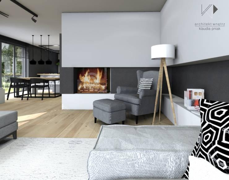 Kominek w salonie : styl , w kategorii Salon zaprojektowany przez Architekt wnętrz Klaudia Pniak