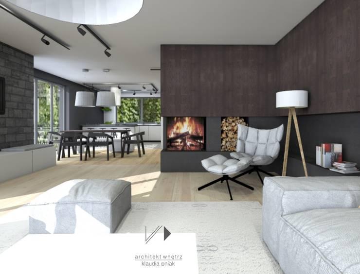 Salon z kominkiem : styl , w kategorii Salon zaprojektowany przez Architekt wnętrz Klaudia Pniak