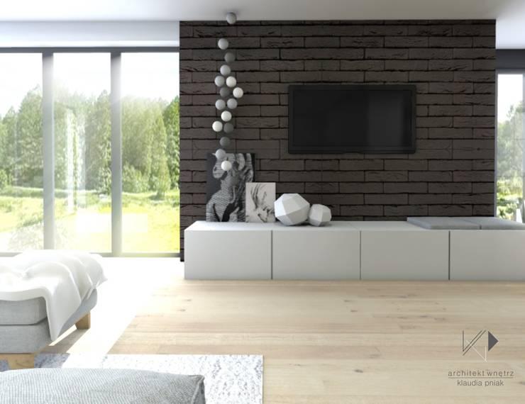 Czarna cegła w salonie : styl , w kategorii Salon zaprojektowany przez Architekt wnętrz Klaudia Pniak