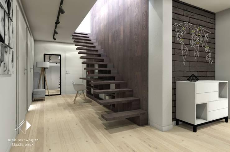Schody z miejscem do pracy : styl , w kategorii Korytarz, przedpokój zaprojektowany przez Architekt wnętrz Klaudia Pniak