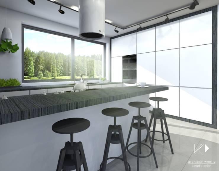 Czarno-biała kuchnia : styl , w kategorii Kuchnia zaprojektowany przez Architekt wnętrz Klaudia Pniak