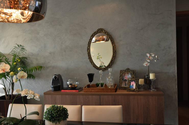 Sala de Jantar: Salas de jantar  por Novità - Reformas e Soluções em Ambientes