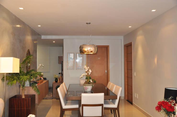 Sala de jantar: Salas de jantar modernas por Novità - Reformas e Soluções em Ambientes