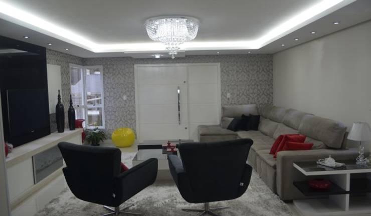 Iluminação e gesso: Salas de estar  por Ésse Arquitetura e Interiores
