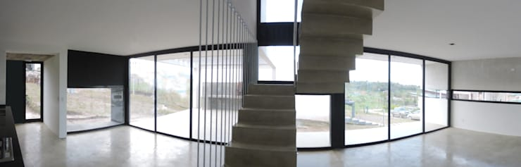 Casa LL: Pasillos y recibidores de estilo  por jose m zamora ARQ