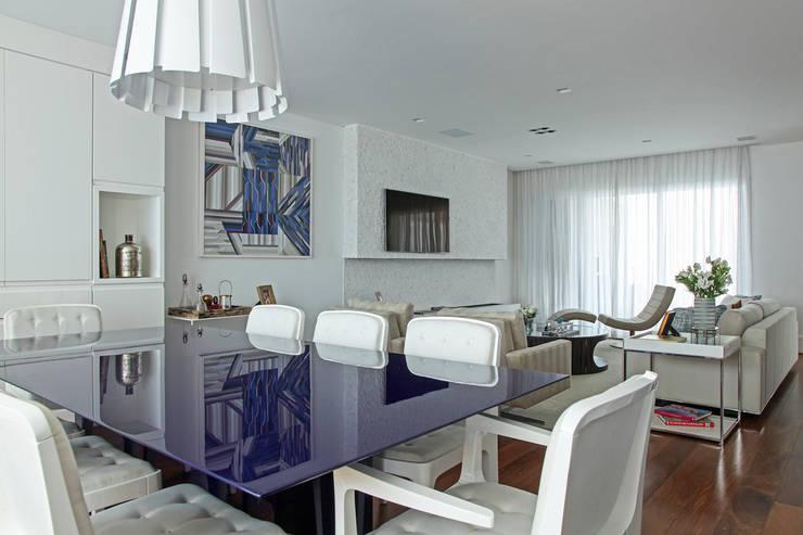 Casa Brooklin: Salas de jantar  por Figoli-Ravecca Arquitetos Associados