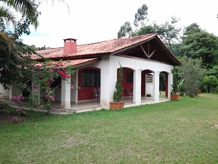 Casas  por Mina Arquitetura & Construções