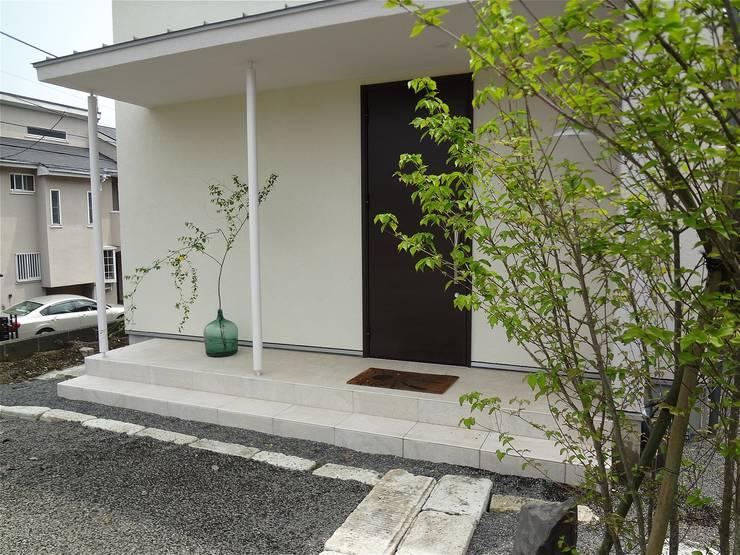 Casas de estilo  de atelier shige architects /アトリエシゲ一級建築士事務所, Moderno Piedra