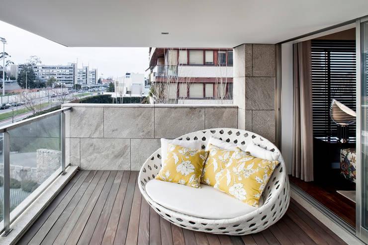 Apartamento Porto: Terraços  por Jorge Cassio Dantas Lda