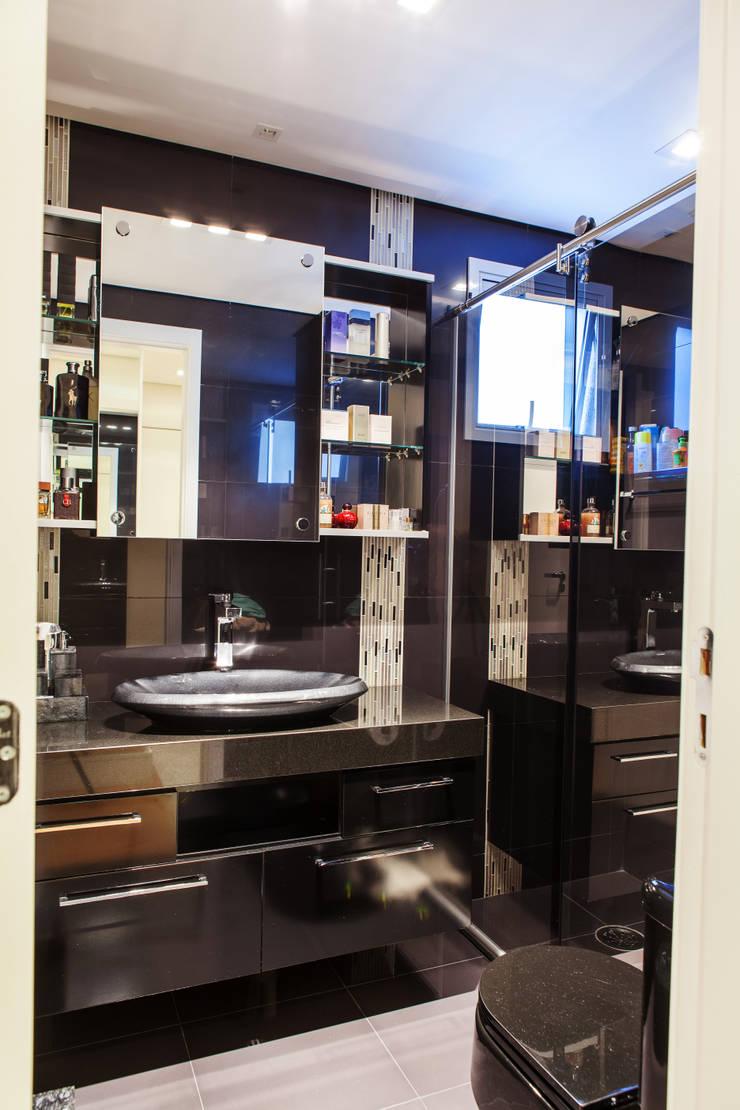 Conforto e Bem Estar: Banheiros  por Lilian Barbieri Interior Design