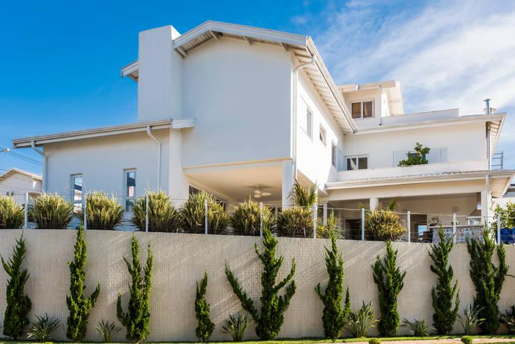 Casas de estilo  por MM Arquitetura e Urbanismo