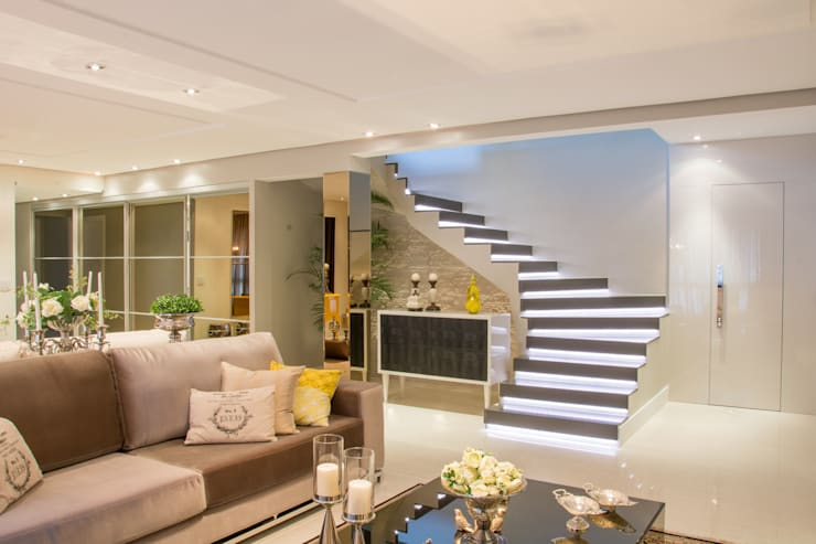 Living: Salas de estar  por Michele Moncks Arquitetura