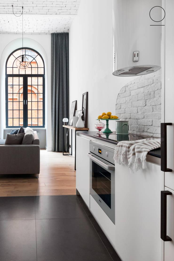 Loft w Łodzi : styl , w kategorii Kuchnia zaprojektowany przez OIKOI
