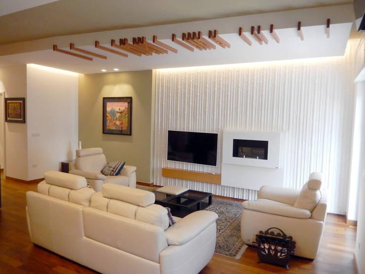 Casa AS: Soggiorno in stile  di Nicola Sacco Architetto