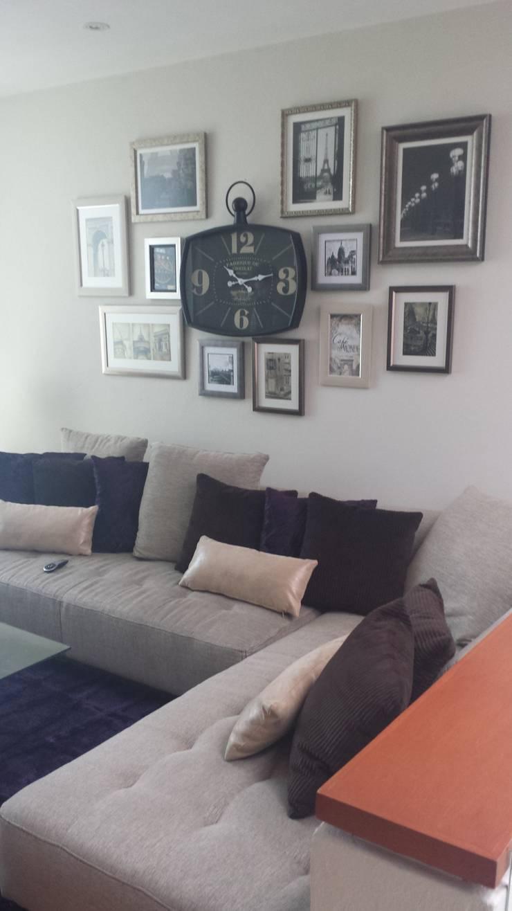 La sala, la sala de TV y la recamara del bebe: Salas de estilo  por Paola Hernandez Studio Comfort Design