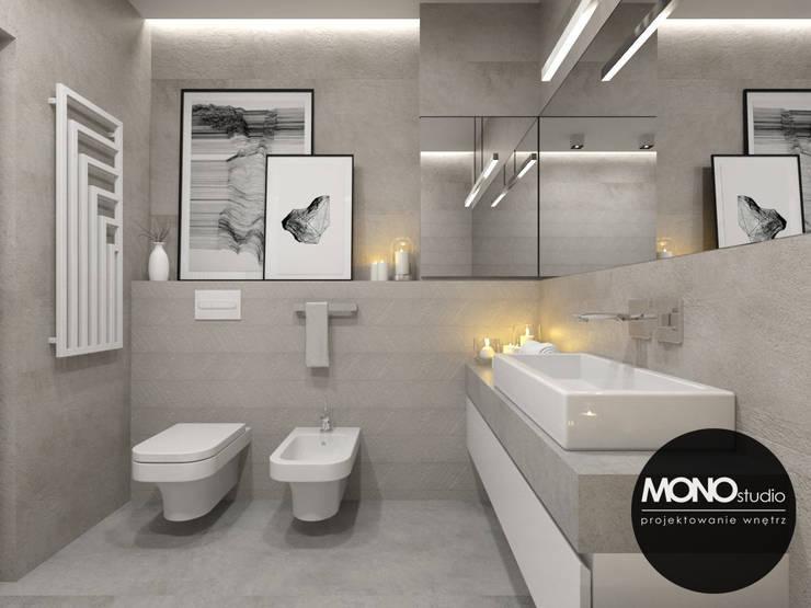 Baños de estilo  por MONOstudio
