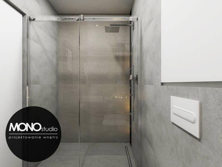 Surowe materiały w ciepłym wnętrzu: styl , w kategorii Łazienka zaprojektowany przez MONOstudio,