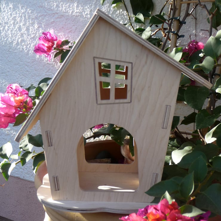 Jardín de estilo  por wood-manufaktur