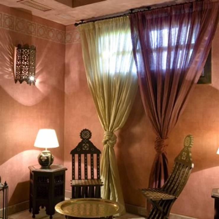 estilo marroquí: Salones de estilo  de Taller de Interiores Mediterraneos