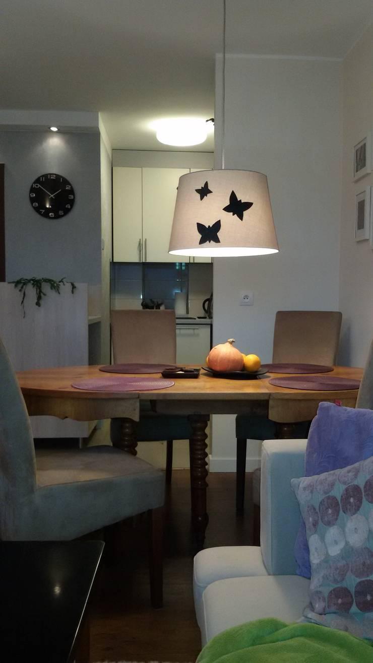 Modern dining room by Studio Projektowania doMIKOart Modern
