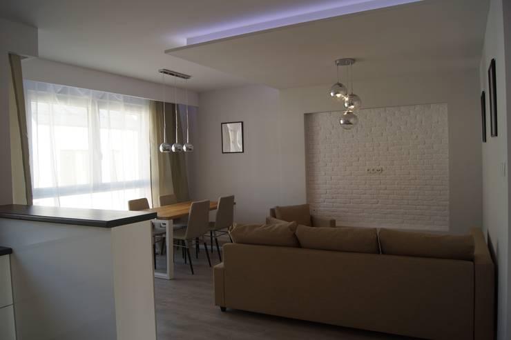 Mieszkanie pokazowe Wrocław: styl , w kategorii Salon zaprojektowany przez Julia Domagała wnętrza,Nowoczesny