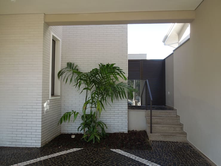 Residencia Campinas/SP: Casas  por Vieitez Bernils Arquitetos Ltda.,