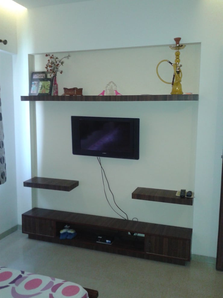 TV unit in the Guest Room: modern Bedroom by Global Associiates