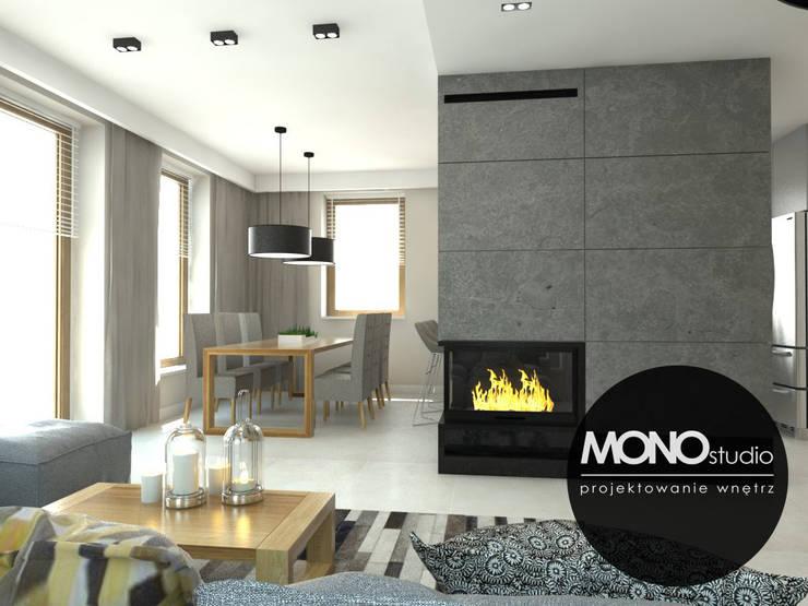 Nowoczesna minimalistyczna kuchnia w jasnej tonacji .: styl , w kategorii Salon zaprojektowany przez MONOstudio