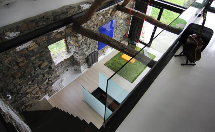 Salas de estilo  por Tagarro-De Miguel Arquitectos