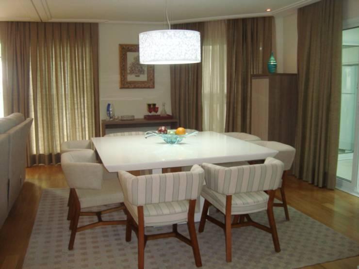 APARTAMENTO 240m²: Salas de jantar  por Nanci Pedro Arquitetura,
