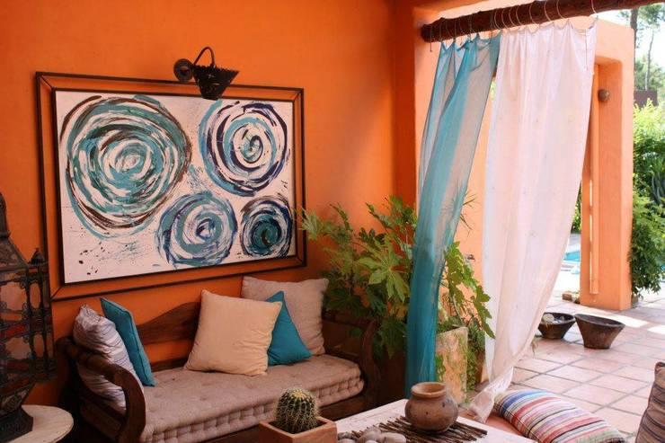 Ambientes exóticos: Casas  por Alpendre Decoração