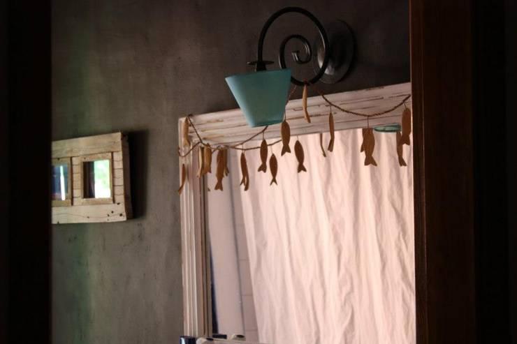 Ambientes exóticos: Casas de banho  por Alpendre Decoração
