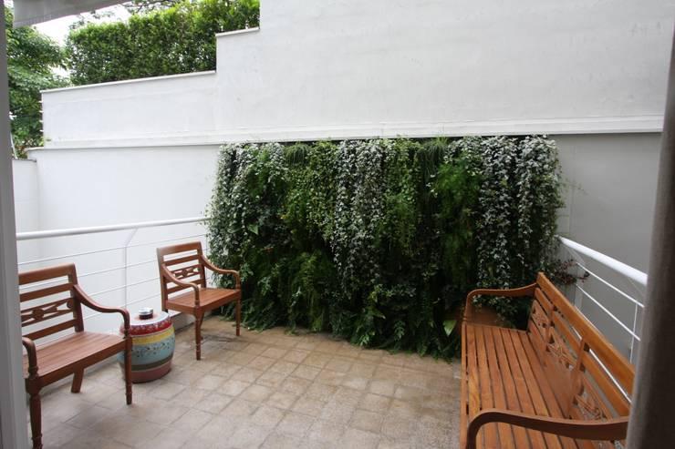 Parede verde: Jardins  por HZ Paisagismo,Tropical