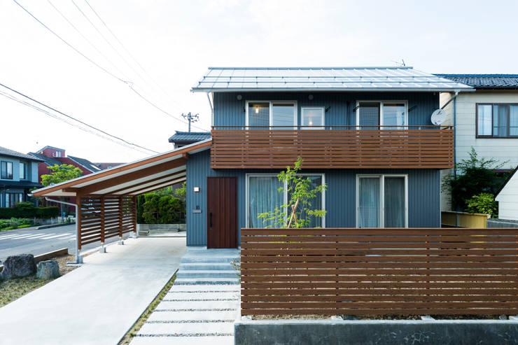 Casas de estilo moderno por 株式会社山口工務店