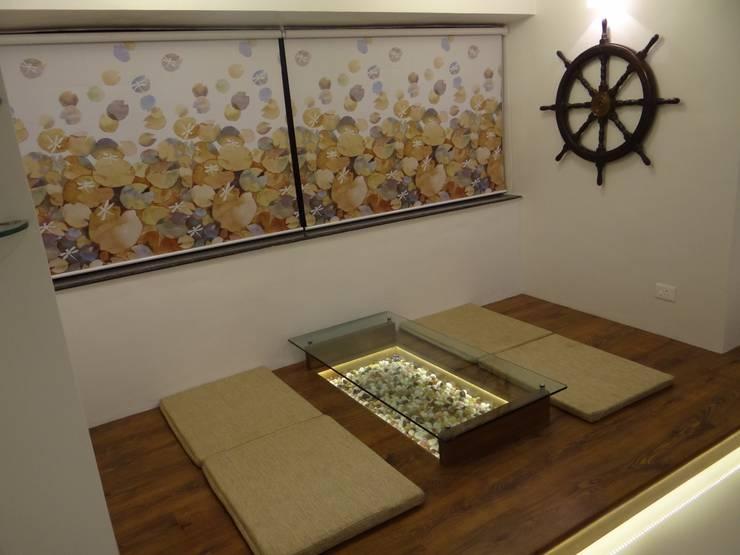 Rajeev Sapre Residence: rustic Living room by Nuvo Designs