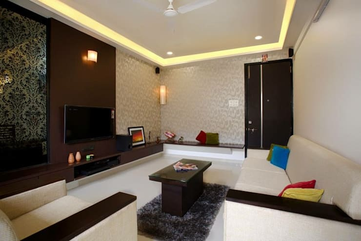 2BHK Residence:  Living room by INTERIOR WORKS