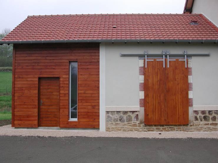 Extension bois: Maisons de style  par Kauri Architecture