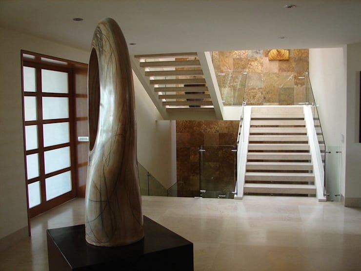 Casa Agave: Pasillos y recibidores de estilo  por AD ARQUITECTOS