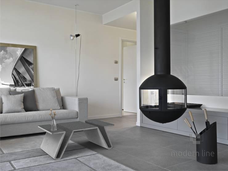 Betonowy stół w salonie: styl , w kategorii Salon zaprojektowany przez Modern Line