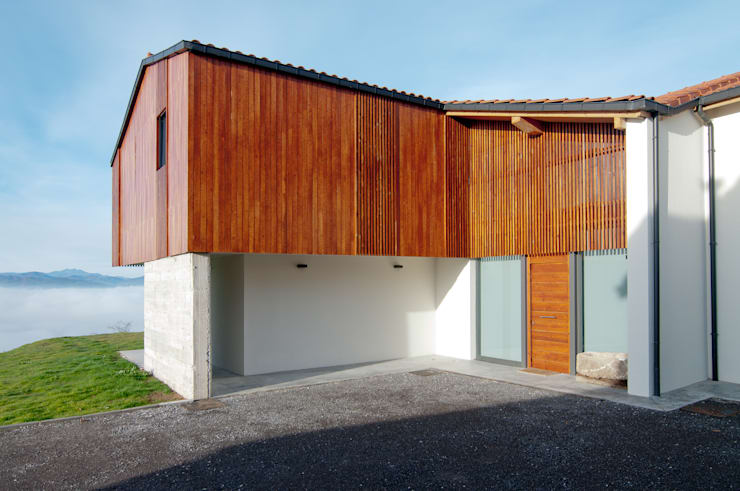 Projekty, wiejskie Domy zaprojektowane przez RUBIO · BILBAO ARQUITECTOS